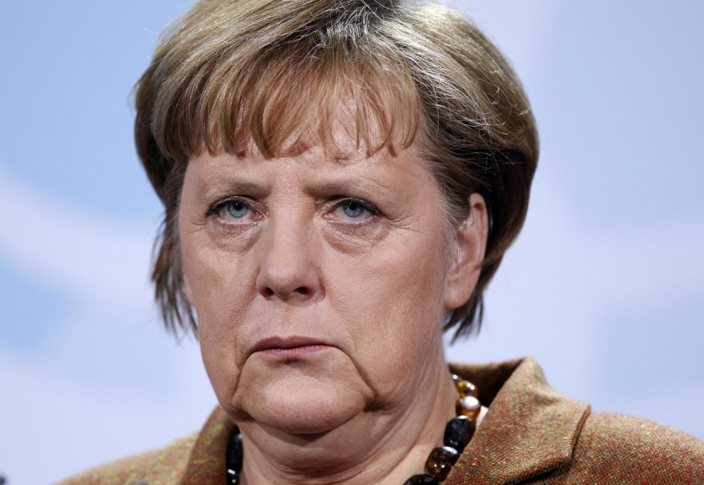 German Chancellor Angela Merkel attends a joint news conference with Palestinian Authority President Mahmoud Abbas, not seen. during their meeting at the Chancellery in Berlin, Germany, Thursday, Jan. 19, 2012. (AP Photo/Michael Sohn)